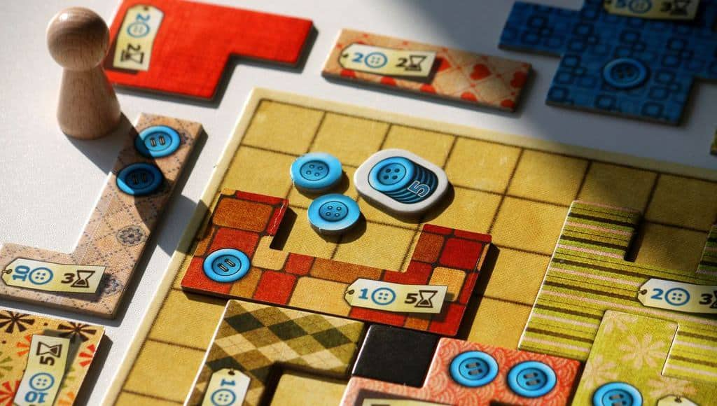 Patchwork may appear plain at first, hiding one of the best board games for 2 players we have played so far causally.